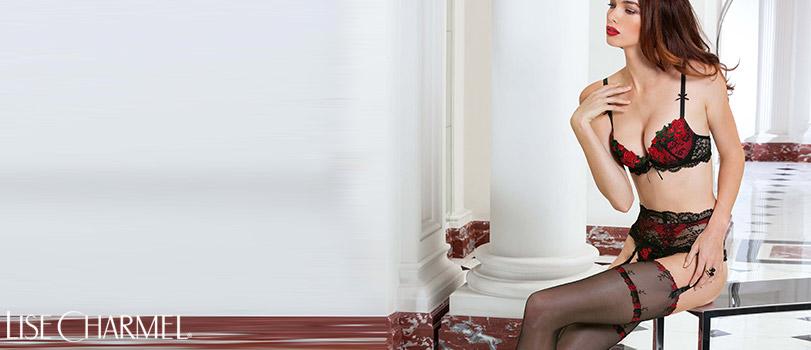 Femme portant un porte jarretelles noir et rouge de la marque lise charmel et de la collection maestria andalouse