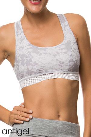 packshot mannequin porte brassière soutien-gorge de sport de la marque Antigel de Lise Charmel collection Cocoon Bien-Être en couleur gris chiné dos croisé